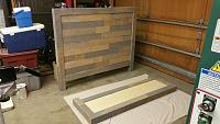Headboard panel with veneers applied and footboard being prepped for application of the veneers